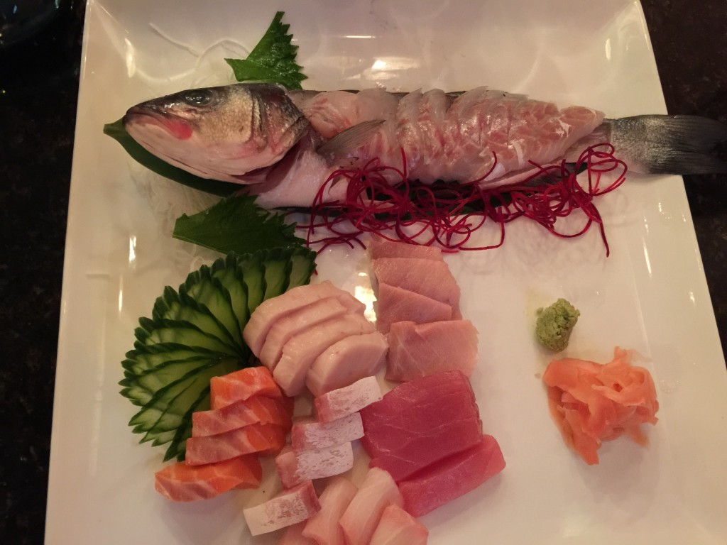 Sashimi patter featuring whole branzino with a ponzu-based sauce